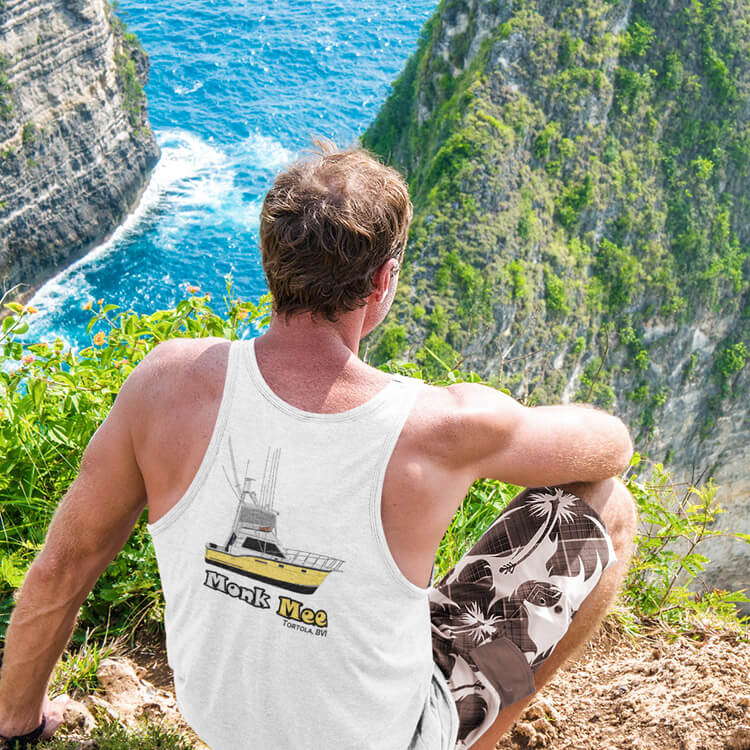 An image of a man on  cliff wearing a tanktop of his boat from CustomYachtShirts.com.